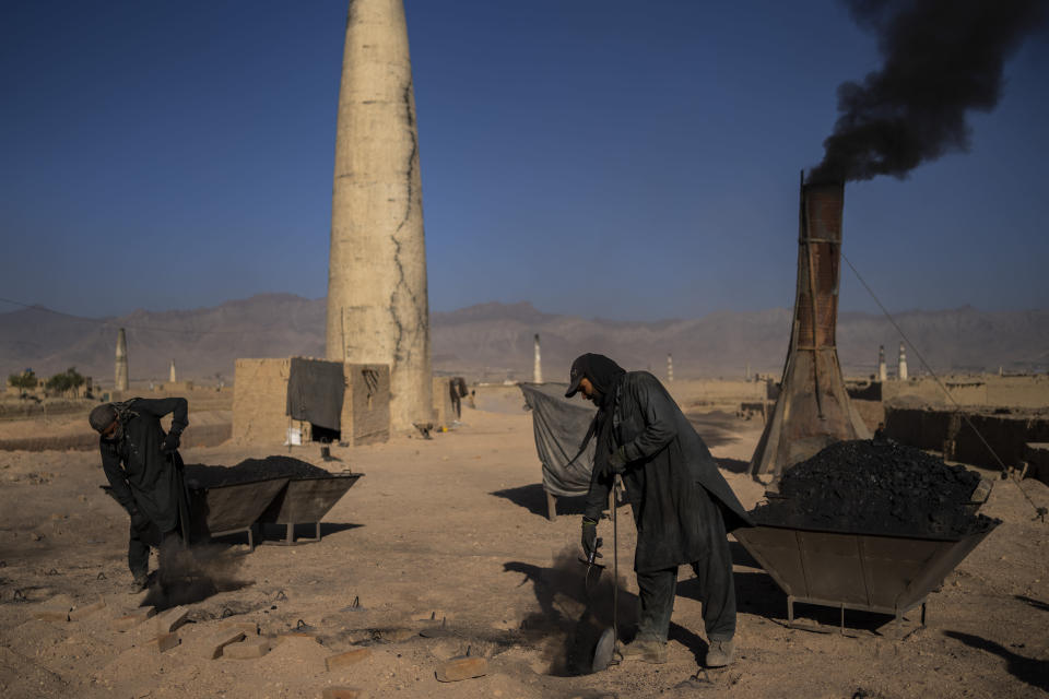 Afghan laborers work at a brick factory in Deh Sabz, on the outskirts of Kabul, Afghanistan, Sunday, Sept. 26, 2021. (AP Photo/Bernat Armangue)
