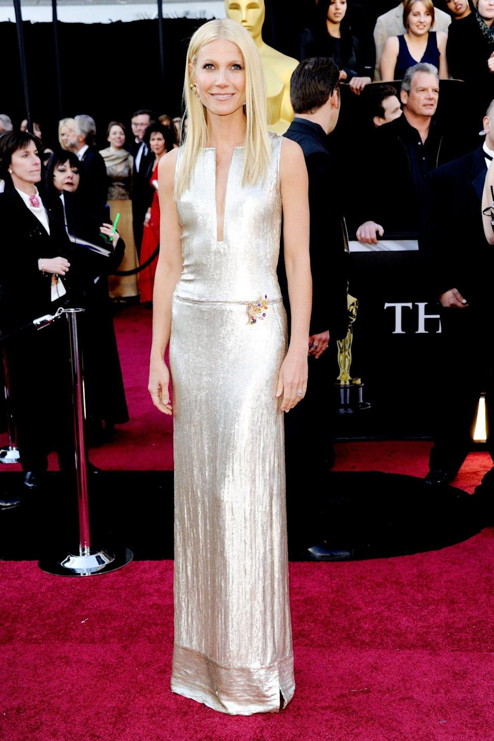 """<p>Gwyneth Paltrow dazzled in silver Calvin Klein Collection on the red carpet. She may look calm and collected, but the star <a href=""""https://variety.com/2019/film/news/gwyneth-paltrow-singing-oscars-country-strong-1203147436/"""" rel=""""nofollow noopener"""" target=""""_blank"""" data-ylk=""""slk:admitted"""" class=""""link rapid-noclick-resp"""">admitted</a> that the 2011 Oscars were responsible for """"the most terrifying moment"""" of her life: Her performance of """"Coming Home"""" from <em>Country Strong</em>, which was nominated for Best Original Song. </p>"""