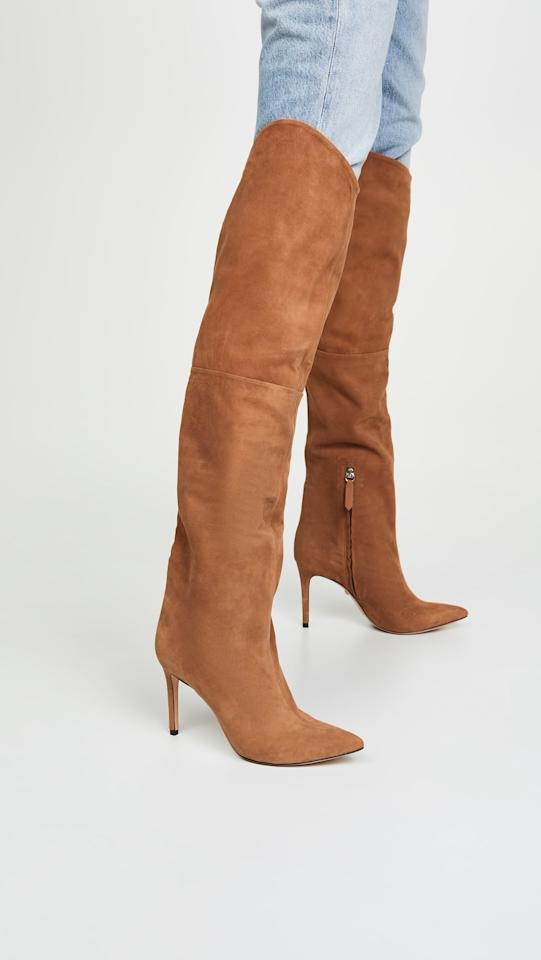 """<p>Wear these <a href=""""https://www.popsugar.com/buy/Schutz-Anamaria-Boots-499087?p_name=Schutz%20Anamaria%20Boots&retailer=shopbop.com&pid=499087&price=395&evar1=fab%3Aus&evar9=45210111&evar98=https%3A%2F%2Fwww.popsugar.com%2Ffashion%2Fphoto-gallery%2F45210111%2Fimage%2F46727842%2FSchutz-Anamaria-Boots&list1=shopping%2Cfall%20fashion%2Cshoes%2Cboots%2Cfall%2Cwinter%2Cwinter%20fashion&prop13=mobile&pdata=1"""" rel=""""nofollow"""" data-shoppable-link=""""1"""" target=""""_blank"""" class=""""ga-track"""" data-ga-category=""""Related"""" data-ga-label=""""https://www.shopbop.com/anamaria-boot-schutz/vp/v=1/1528658873.htm?folderID=13465&amp;fm=other-shopbysize-viewall&amp;os=false&amp;colorId=11084"""" data-ga-action=""""In-Line Links"""">Schutz Anamaria Boots</a> ($395) with skinny jeans.</p>"""