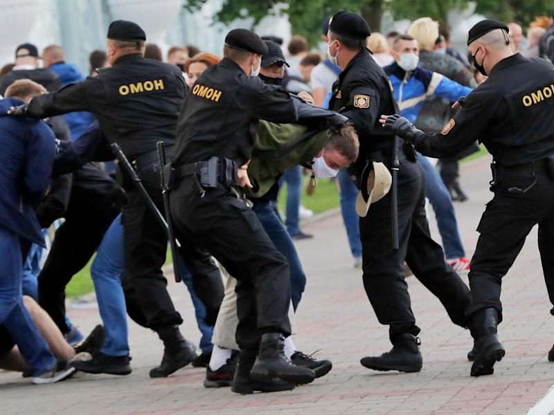 Police officers detain protests during a protest rally in Minsk: AP