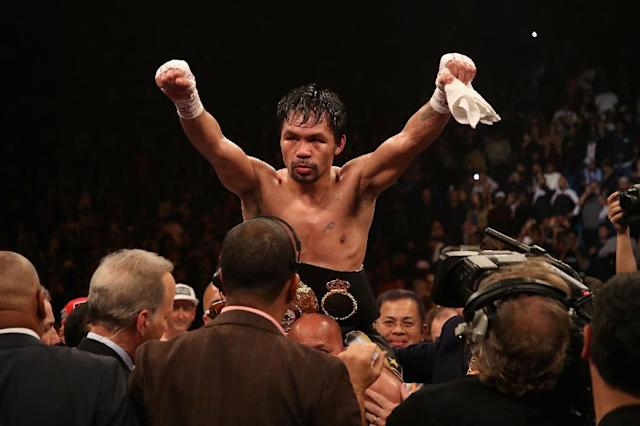 Pacquiao improved to 61-7-2 with 39 knockouts, winning on all three judges scorecards, including by one tally of 117-111 (AFP Photo/Christian Petersen)