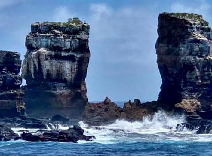 Handout photo released by the Ecuadorean Ministry of Environment of the Darwin Arch after it collapsed near Darwin Island, Galapagos, Ecuador, on May 17, 2021.