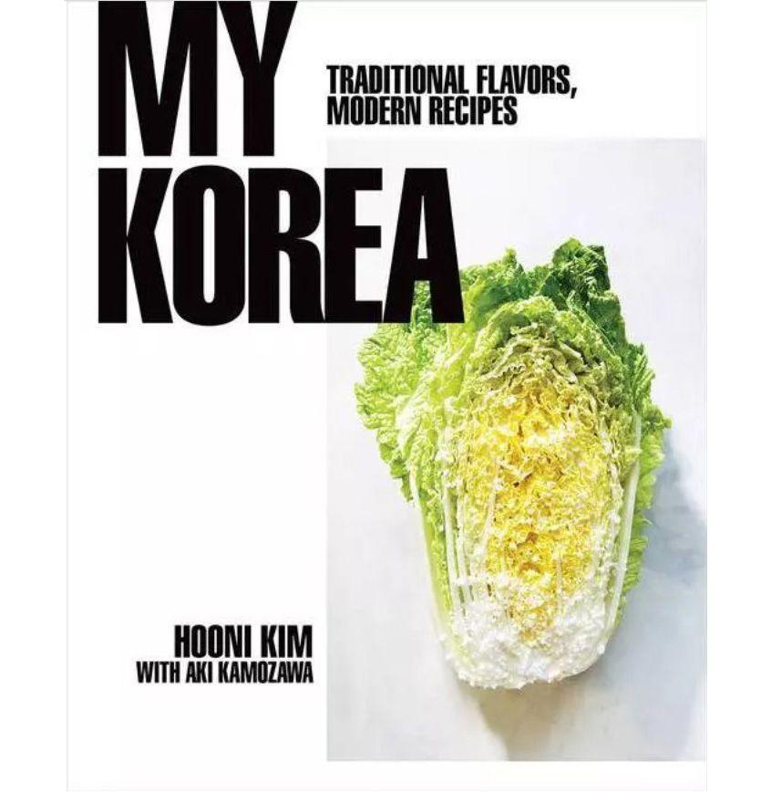 """<p><strong>By Hooni Kim</strong></p><p>amazon.com</p><p><strong>$27.99</strong></p><p><a href=""""https://www.amazon.com/dp/0393239721?tag=syn-yahoo-20&ascsubtag=%5Bartid%7C10054.g.31206127%5Bsrc%7Cyahoo-us"""" rel=""""nofollow noopener"""" target=""""_blank"""" data-ylk=""""slk:Pre-Order"""" class=""""link rapid-noclick-resp"""">Pre-Order</a></p><p><em>Out April 7</em></p><p>Kim received the first-ever Michelin star awarded to a Korean restaurant for his joint Danji in New York. The masterful presentation of small, tapas-style Korean dishes he mastered there naturally came from his background in Korean cooking, which he recounts here in a modern, invigorating cookbook that still pays homage to tradition. As you'll learn, it all starts with doenjang, ganjang, and gochujang. <br></p>"""