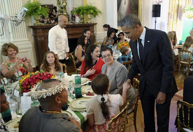 "President Barack Obama greets guests of the second annual White House ""Kids' State Dinner"" in the East Room of the White House in Washington, Tuesday, July 9, 2013. First lady Michelle Obama welcomed 54 children to the White House for creating winning recipes as part of a healthy lunch contest. (AP Photo/Susan Walsh)"