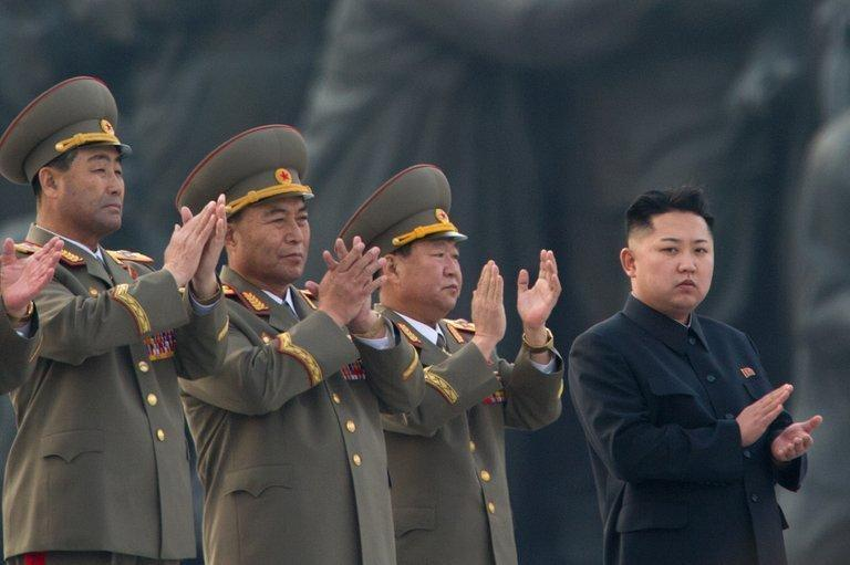 North Korean leader Kim Jong-Un (R) attends the unveiling of statues of former leaders in Pyongyang on April 13, 2012