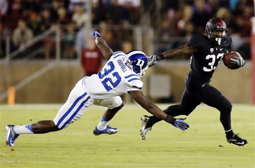 Stanford running back Stepfan Taylor, right, runs past Duke safety August Campbell during the first half of an NCAA college football game in Stanford, Calif., Saturday, Sept. 8, 2012. (AP Photo/Marcio Jose Sanchez)