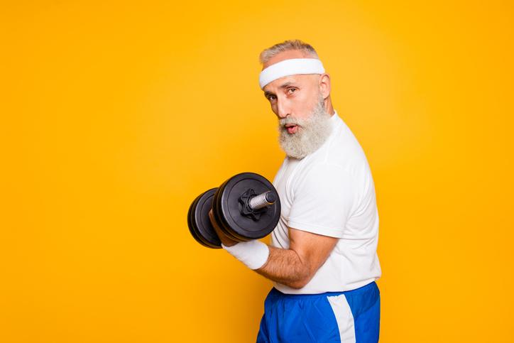 An older man doing a bicep curl.