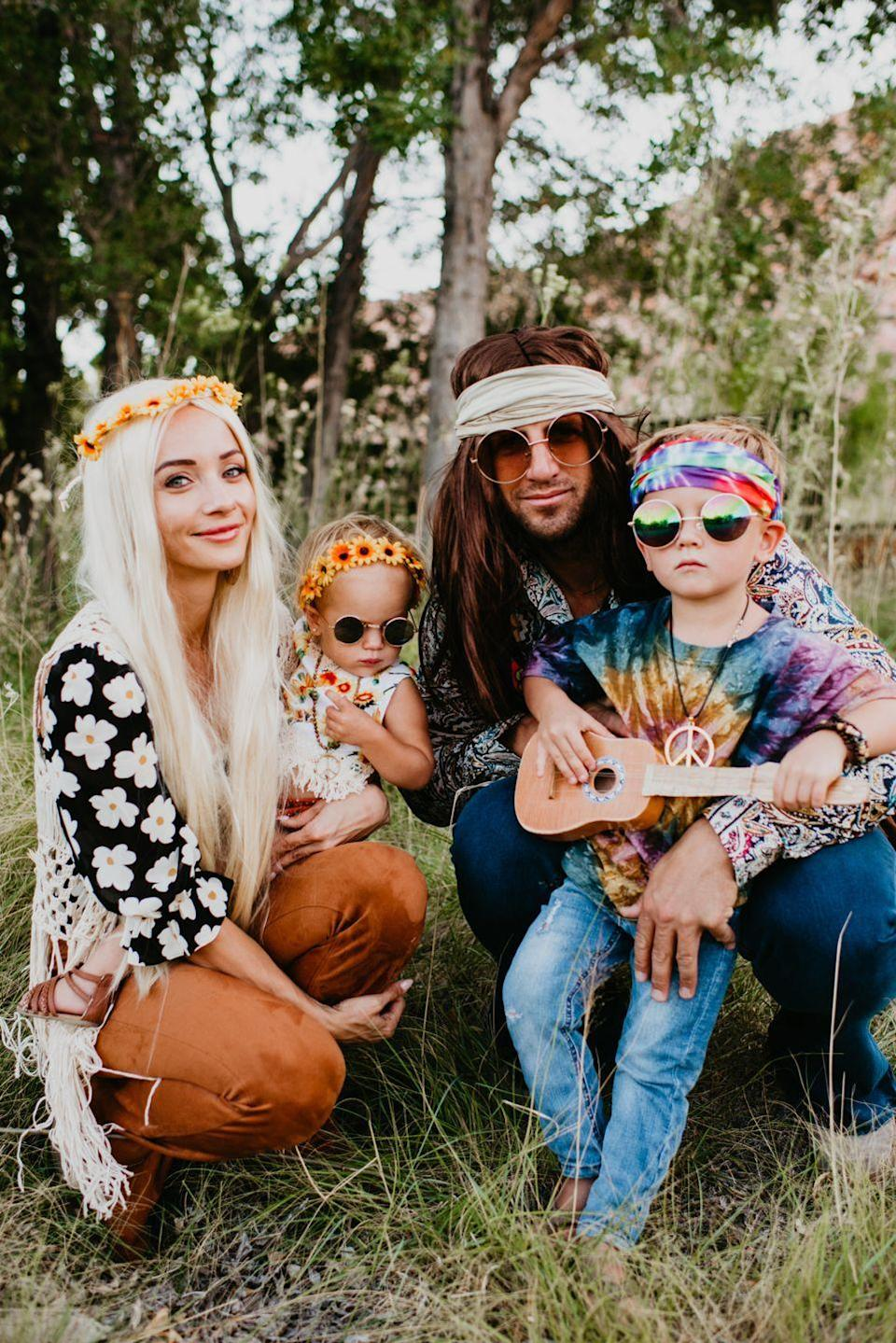 """<p>If you're feeling nostalgic this Halloween, why not embrace a 1970s vibe with this hippie-inspired ensemble? Between the bell bottoms, the flower crowns and plenty of tie dye, you'll be the grooviest family on the block!</p><p><strong>Get the tutorial at <a href=""""https://outfitsandoutings.com/diy-hippie-costume-ideas-for-halloween/"""" rel=""""nofollow noopener"""" target=""""_blank"""" data-ylk=""""slk:Outfits & Outings"""" class=""""link rapid-noclick-resp"""">Outfits & Outings</a>.</strong></p><p><a class=""""link rapid-noclick-resp"""" href=""""https://www.amazon.com/DDazzling-Eucalyptus-Headband-Headpiece-Sunflower/dp/B07QJWWDYV/ref=sr_1_14?dchild=1&keywords=flower+crown&qid=1596030492&sr=8-14&tag=syn-yahoo-20&ascsubtag=%5Bartid%7C10050.g.29074815%5Bsrc%7Cyahoo-us"""" rel=""""nofollow noopener"""" target=""""_blank"""" data-ylk=""""slk:SHOP FLOWER CROWNS"""">SHOP FLOWER CROWNS</a></p>"""