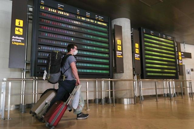 A passenger arrives in Valencia, Spain from Zurich, Switzerland, which has seen rising cases. Photo: Ivan Terron/Europa Press via Getty Images