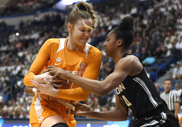 Tennessee's Lou Brown, left, and Connecticut's Aubrey Griffin fight for possession of the ball in the first half of an NCAA college basketball game, Thursday, Jan. 23, 2020, in Hartford, Conn. (AP Photo/Jessica Hill)