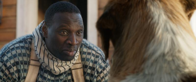 """This undated image provided by 20th Century Fox shows actor Omar Sy in a scene from the film """"Call of the Wild."""" (20th Century Fox via AP)"""