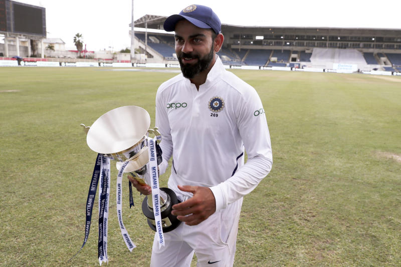 India's captain Virat Kohli walks with the series trophy after day four of the second Test cricket match against West Indies at Sabina Park cricket ground in Kingston, Jamaica Monday, Sept. 2, 2019. India won by 257 runs. (AP Photo/Ricardo Mazalan)