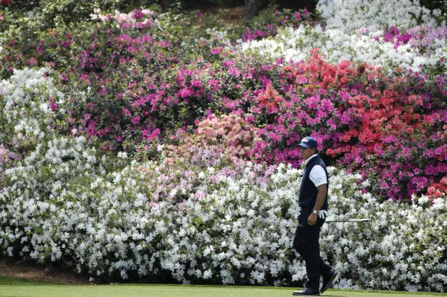 Phil Mickelson of the U.S. looks over the 12th green from the 13th fairway during second round play of the 2018 Masters golf tournament at the Augusta National Golf Club in Augusta, Georgia, U.S., April 6, 2018. REUTERS/Mike Segar