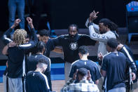Brooklyn Nets guard James Harden (13) looks up from the Nets huddle before the first half of an NBA basketball game against the Houston Rockets Wednesday, March 3, 2021, in Houston. (Mark Mulligan/Houston Chronicle via AP)