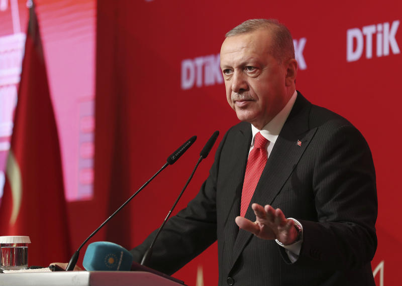 """Turkey's President Recep Tayyip Erdogan addresses the World Turkish Business Council meeting, in Baku, Azerbaijan, Monday. Oct. 14, 2019. Erdogan says Turkey's military offensive into northeast Syria is as """"vital"""" to Turkey as its 1974 military intervention in Cyprus, which split the island in two. (Presidential Press Service via AP, Pool)"""