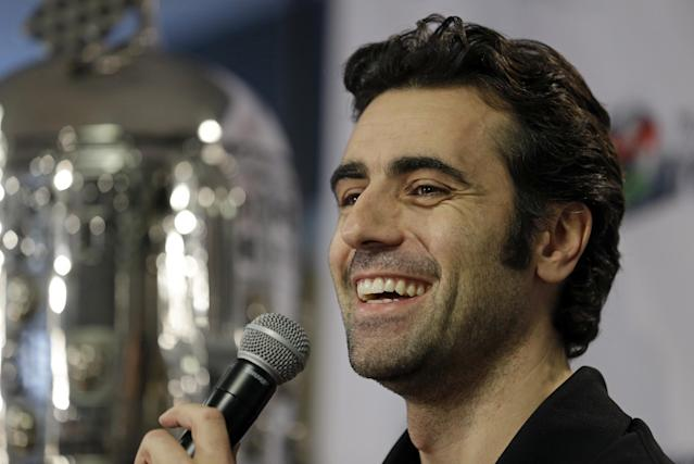 Race driver Dario Franchitti, of Scotland, answers a question during his first public appearance since a crash ended his IndyCar career during a press conference in Indianapolis, Thursday, Dec. 19, 2013. The four-time series champ and three-time Indianapolis 500 winner will not race again because of the risks involved with another head injury. He suffered a concussion, spinal fractures and a broken right ankle in the Oct. 6 crash in Houston. (AP Photo/Michael Conroy)