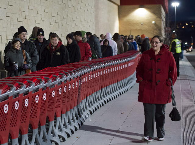 Shoppers wait in line at the Target store in Dartmouth, N.S. on Friday, Nov. 29, 2013. (THE CANADIAN PRESS/Andrew Vaughan)
