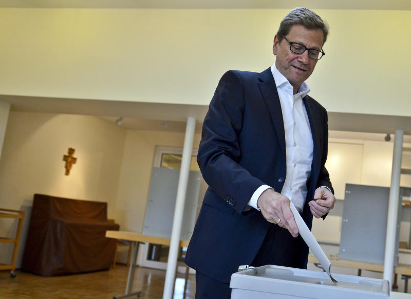 German Foreign Minister Guido Westerwelle of the Free Democratic party FDP, casts his vote in Bonn, Germany, Sunday, Sept. 22, 2013. 62 million voters in Germany are entitled to elect a new parliament on Sunday. (AP Photo/Sascha Schuermann)