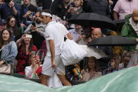 Switzerland's Roger Federer leaves the court as rain delays play during the men's singles fourth round match against Italy's Lorenzo Sonego on day seven of the Wimbledon Tennis Championships in London, Monday, July 5, 2021. (AP Photo/Kirsty Wigglesworth)