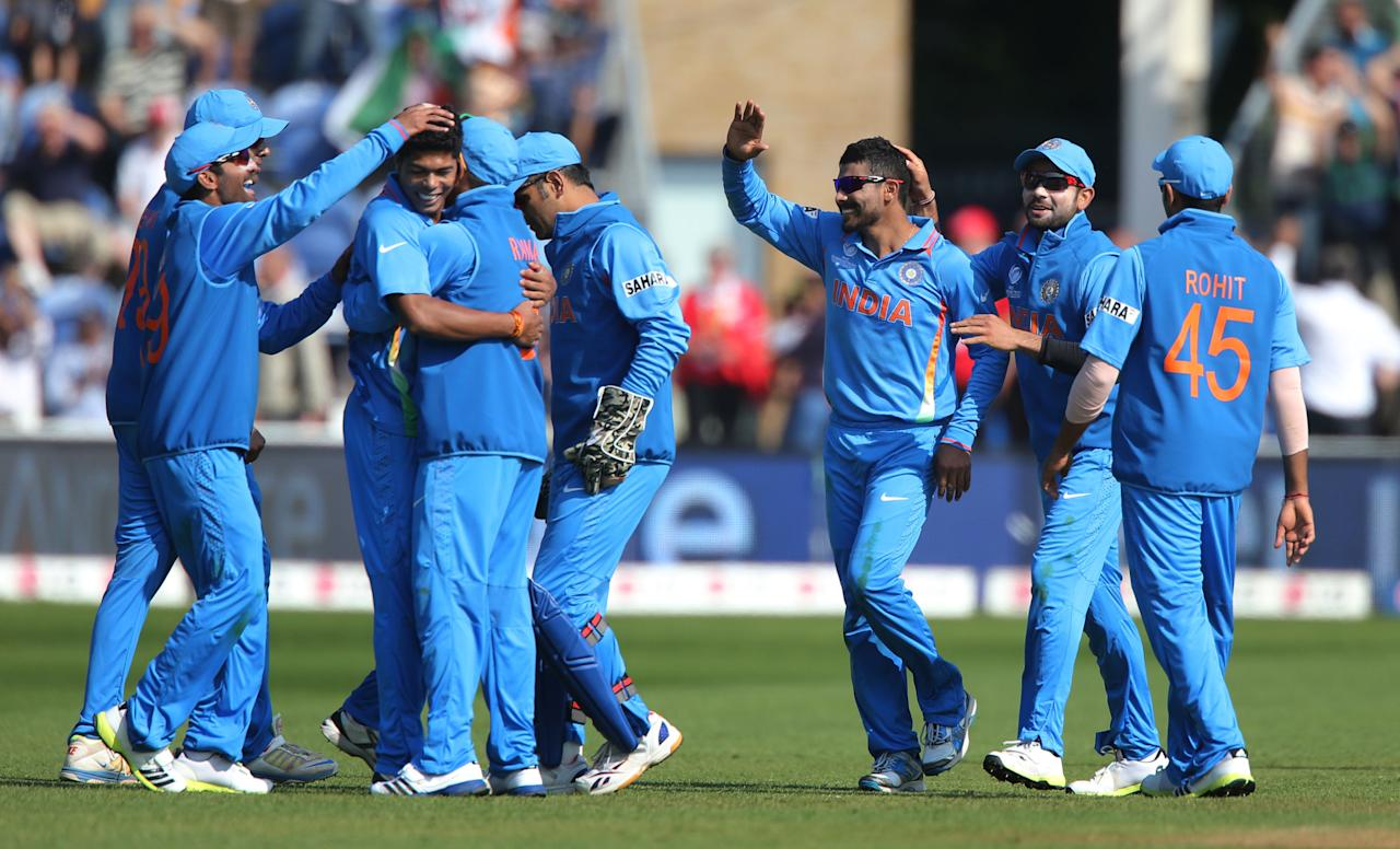 India's Ravindrasinh Jadeja (centre) celebrates catching South Africa batsman and captain AB De Villiers on opening day of the ICC Champions Trophy. The SWALEC Stadium, Cardiff.