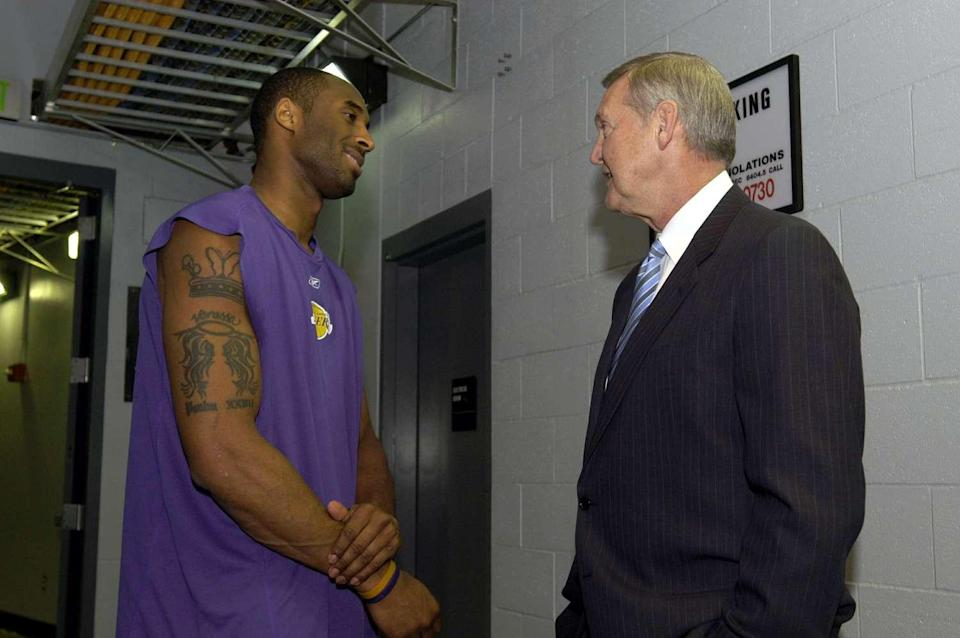 Kobe Bryant talks with Jerry West at a reunion of the 1985 championship Lakers team on April 11, 2005, at Staples Center.