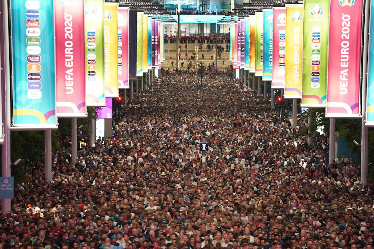 England fans celebrate outside Wembley Stadium after England qualified for the Euro 2020 final where they will face Italy on Sunday 11th July, following the UEFA Euro 2020 semi final match between England and Denmark. Picture date: Wednesday July 7, 2021.