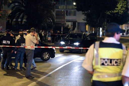 French policemen investigate a crime scene in Ajaccio on September 1