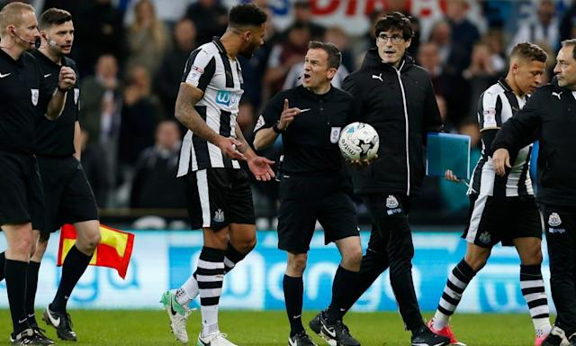 "<span class=""element-image__caption"">The referee Keith Stroud, with ball in hand, has a lot of explaining to do to Newcastle's captain Jamaal Lascelles over the penalty fiasco.</span> <span class=""element-image__credit"">Photograph: Ed Sykes/Reuters</span>"