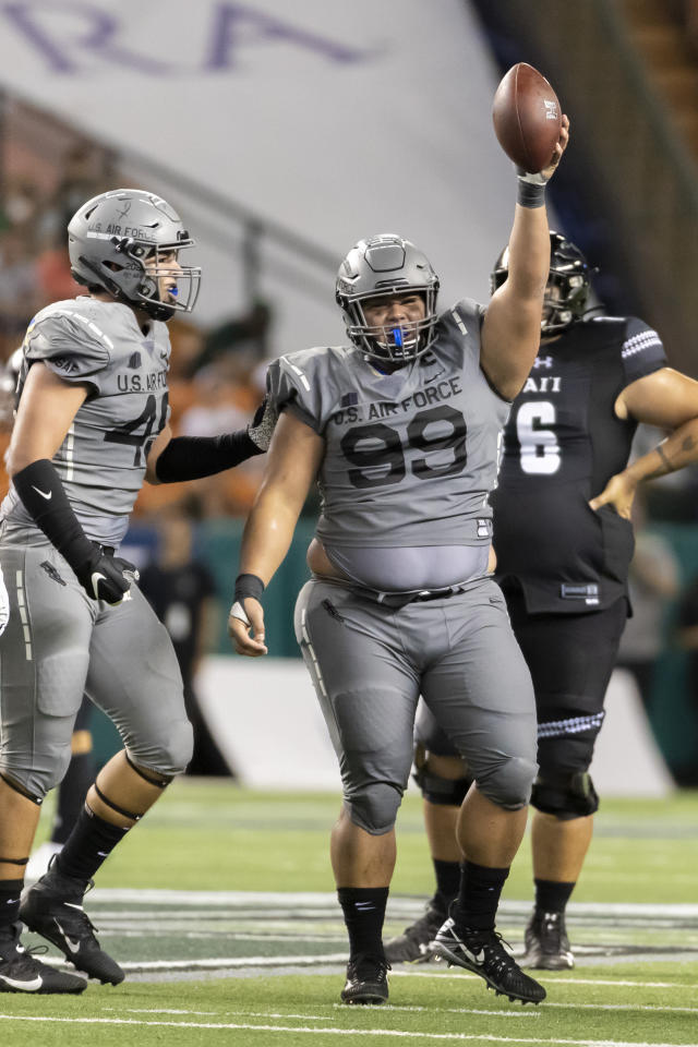 Air Force defensive lineman Mosese Fifita (99) holds up the football celebrating recovering a fumble from Hawaii during the second half of an NCAA college football game, Saturday, Oct. 19, 2019, in Honolulu. Air Force beat Hawaii 56-26. (AP Photo/Eugene Tanner)