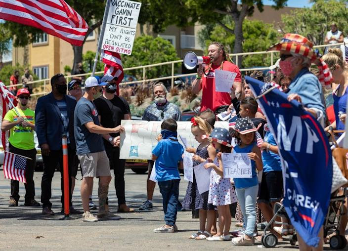 "Lou Uridel, owner of the MetroFlex Gym in Oceanside, spoke on Wednesday at a protest in front of his business. Uridel was arrested and cited last week after refusing to close and has since been released. <span class=""copyright"">(Don Boomer / San Diego Union-Tribune)</span>"