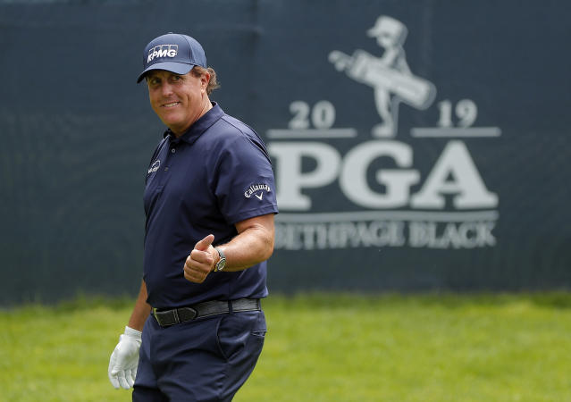 Phil Mickelson responds to spectators as he walks off the 15th tee during the final round of the PGA Championship golf tournament, Sunday, May 19, 2019, at Bethpage Black in Farmingdale, N.Y. (AP Photo/Julie Jacobson)