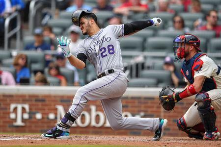 Aug 19, 2018; Atlanta, GA, USA; Colorado Rockies third baseman Nolan Arenado (28) looses his batting helmet on a swing against the Atlanta Braves during the third inning at SunTrust Park. Mandatory Credit: Dale Zanine-USA TODAY Sports