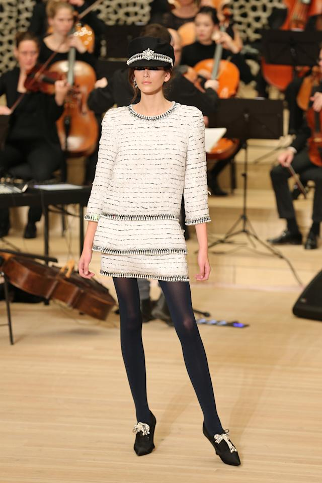 <p>Model Kaia Gerber walks the runway at the Chanel Métiers d'Art show wearing an <span>Elbsegler sailor cap and a white tweed dress. (Photo: Getty Images)</span> </p>