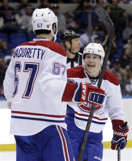 Montreal Canadiens' Brendan Gallagher, right, celebrates his second goal of the third period with teammate Max Pacioretty, during an NHL hockey game against the New York Islanders on Thursday, March 21, 2013, in Uniondale, N.Y. The Canadiens beat the Islanders 5-2. (AP Photo/Seth Wenig)