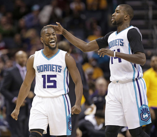 Michael Kidd-Gilchrist (right) will return for at least one more season with the Hornets. (AP Photo/Chuck Burton)