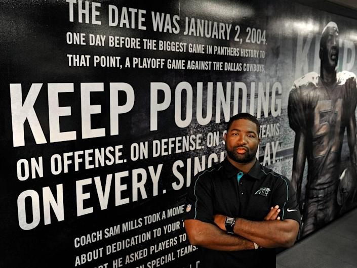 """In 2012, then-Carolina Panthers assistant coach Sam Mills III stood in front of the mural inside Bank of America Stadium depicting his father's """"Keep Pounding"""" speech. His father died of cancer in 2005 and is credited with creating the team's motto: Keep pounding."""