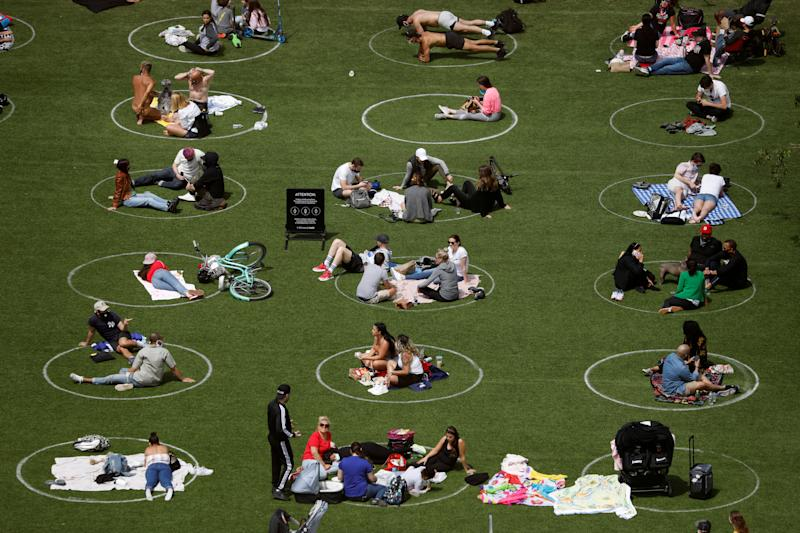 People in Domino Park are seen in circles painted as guidelines for social distancing during the outbreak of the coronavirus disease (COVID-19) in Brooklyn, New York City, U.S., May 24, 2020. REUTERS/Andrew Kelly TPX IMAGES OF THE DAY
