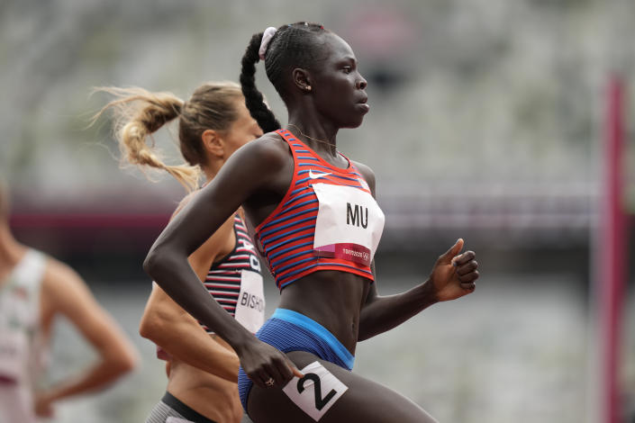 Athing Mu, of United States, wins a heat in the women's 800-meter run at the 2020 Summer Olympics, Friday, July 30, 2021, in Tokyo. (AP Photo/Martin Meissner)
