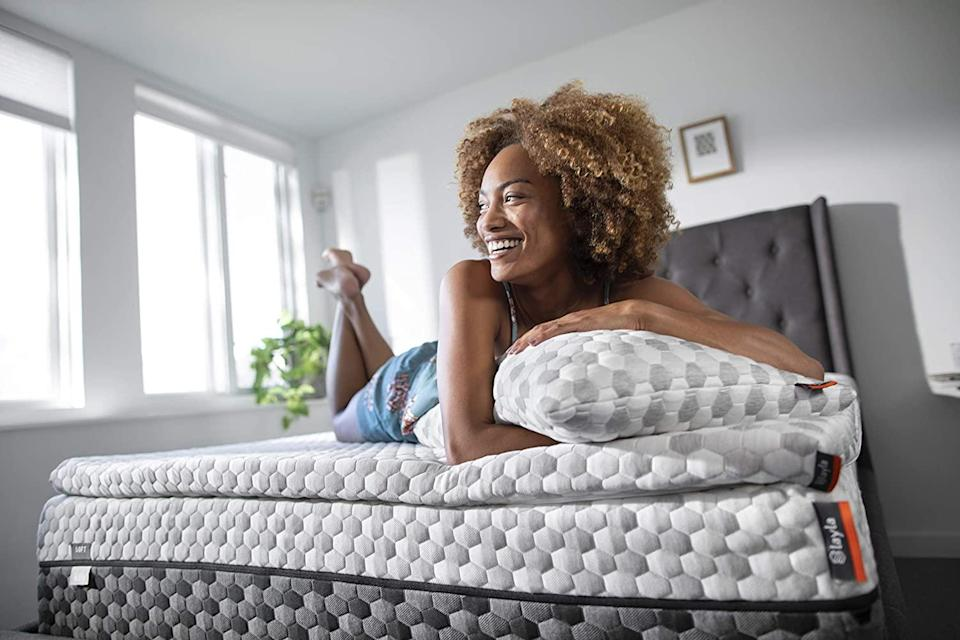 """<h3>Layla Memory Foam Topper</h3><br><strong>Best For: Soft But Supportive Sleep</strong><br>If you're in the market for a sleep experience described as """"like adding an extra layer of clouds to a bed already made of cotton candy,"""" then Laya's topper crafted from cooling, copper-gel-infused memory foam has your number.<br><br><strong>The Hype: 4.5 out of 5 stars</strong><br><br><strong>Sleepers Say:</strong> """"We've had it a couple of months now and this thing seriously transformed our Costco mattress (the wife and I were a little let down by the firmness of it). Adding this gave it that plush feel we were looking for. It helped a ton with side sleeping and laying on my back is more comfortable as well."""" – <em>Charles J, Layla Reviewer</em><br><br><em>Shop </em><strong><em><a href=""""https://laylasleep.com/product/layla-topper/"""" rel=""""nofollow noopener"""" target=""""_blank"""" data-ylk=""""slk:Layla"""" class=""""link rapid-noclick-resp"""">Layla</a></em></strong><br><br><strong>LAYLA</strong> Memory Foam Topper, $, available at <a href=""""https://go.skimresources.com/?id=30283X879131&url=https%3A%2F%2Flaylasleep.com%2Fproduct%2Flayla-topper%2F"""" rel=""""nofollow noopener"""" target=""""_blank"""" data-ylk=""""slk:Layla"""" class=""""link rapid-noclick-resp"""">Layla</a>"""