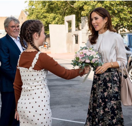 Princess Mary being handed a bouquet of flowers