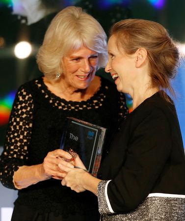 Britain's Camilla, the Duchess of Cornwall presents the Man Booker Prize for Fiction 2018 to British writer Anna Burns during the prize's 50th year, at the Guildhall in London, Britain, October 16, 2018. Frank Augstein/Pool via REUTERS