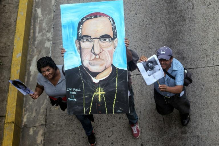 Demonstrators in San Salvador hold an image of Oscar Romero, who was murdered in 1980 and will be canonized by Pope Francis on October 14, to demand justice for his murder