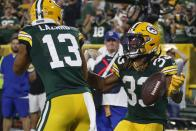 Green Bay Packers' Aaron Jones celebrates his touchdown run with Allen Lazard during the second half of an NFL football game against the Detroit Lions Monday, Sept. 20, 2021, in Green Bay, Wis. (AP Photo/Matt Ludtke)
