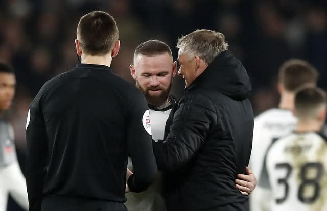 Rooney was embraced by Ole Gunnar Solskjaer at full-time (Martin Rickett/PA)