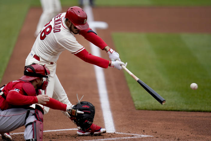 St. Louis Cardinals' Nolan Arenado hits an RBI single during the first inning of a baseball game against the Cincinnati Reds Saturday, April 24, 2021, in St. Louis. (AP Photo/Jeff Roberson)