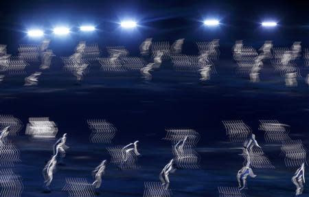Performers take part in the opening ceremony of the 2014 Sochi Winter Olympics, February 7, 2014. REUTERS/Mark Blinch