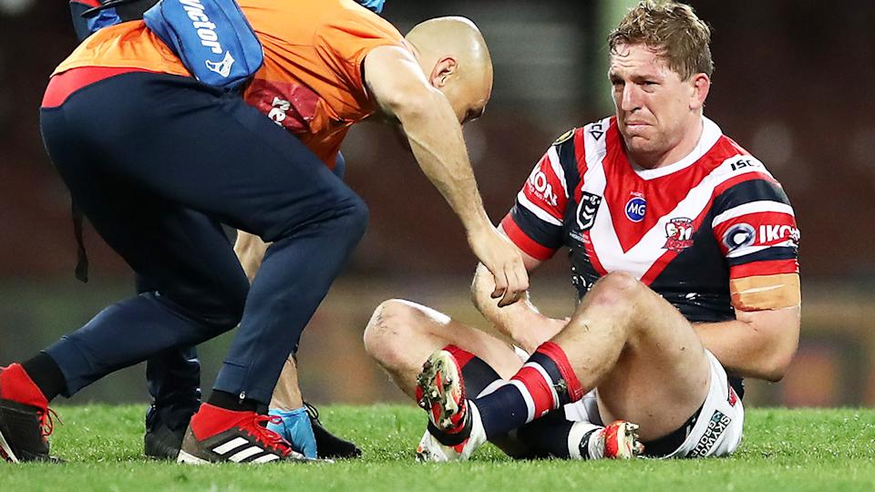 Mitchell Aubusson, pictured here after being injured in the Roosters' loss to the Storm.