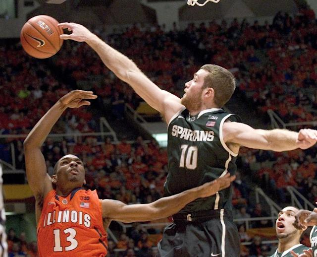 Michigan State's forward Matt Costello (10) knocks a shot away from Illinois' Tracy Abrams (13) during an NCAA college basketball game in Champaign, Ill., on Saturday, Jan. 18, 2014. (AP Photo/Robin Scholz)