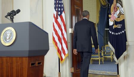 U.S. President Barack Obama departs after delivering a live televised address to the nation on his plans for military action against the Islamic State, from the Cross Hall of the White House in Washington September 10, 2014. REUTERS/Saul Loeb/Pool