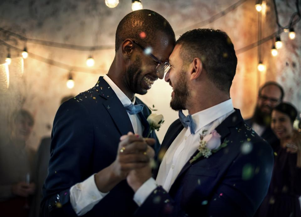 Gay couple having first dance at their wedding